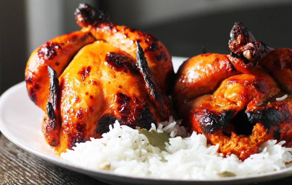 Succulent roasted tandoori cornish game hens.