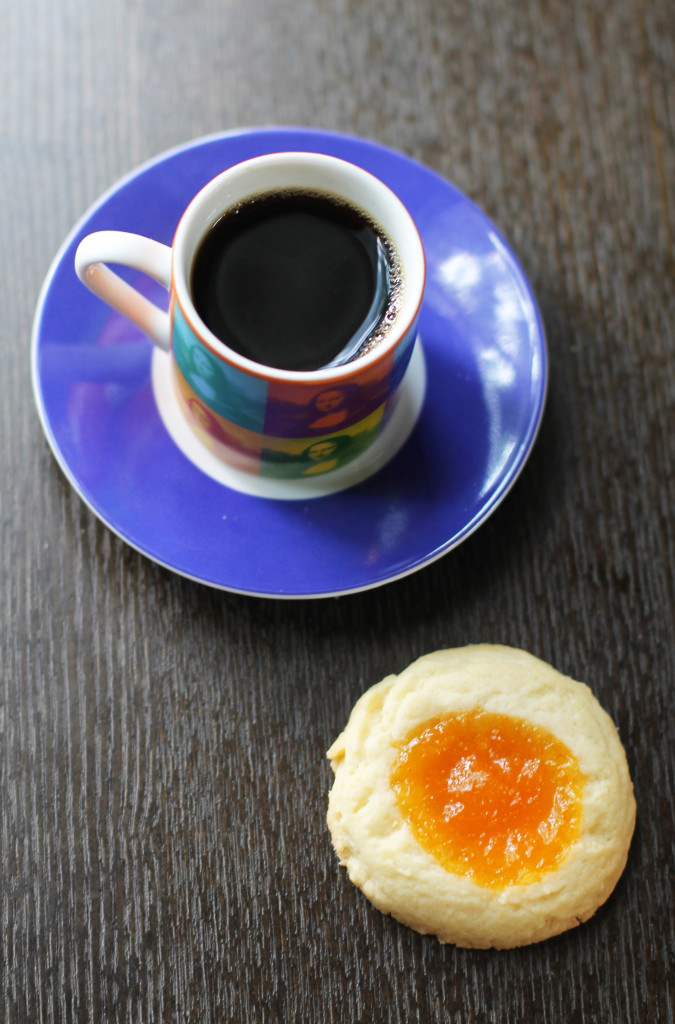 Recipe for delightfully buttery and almond-flavored apricot thumbprint cookies!