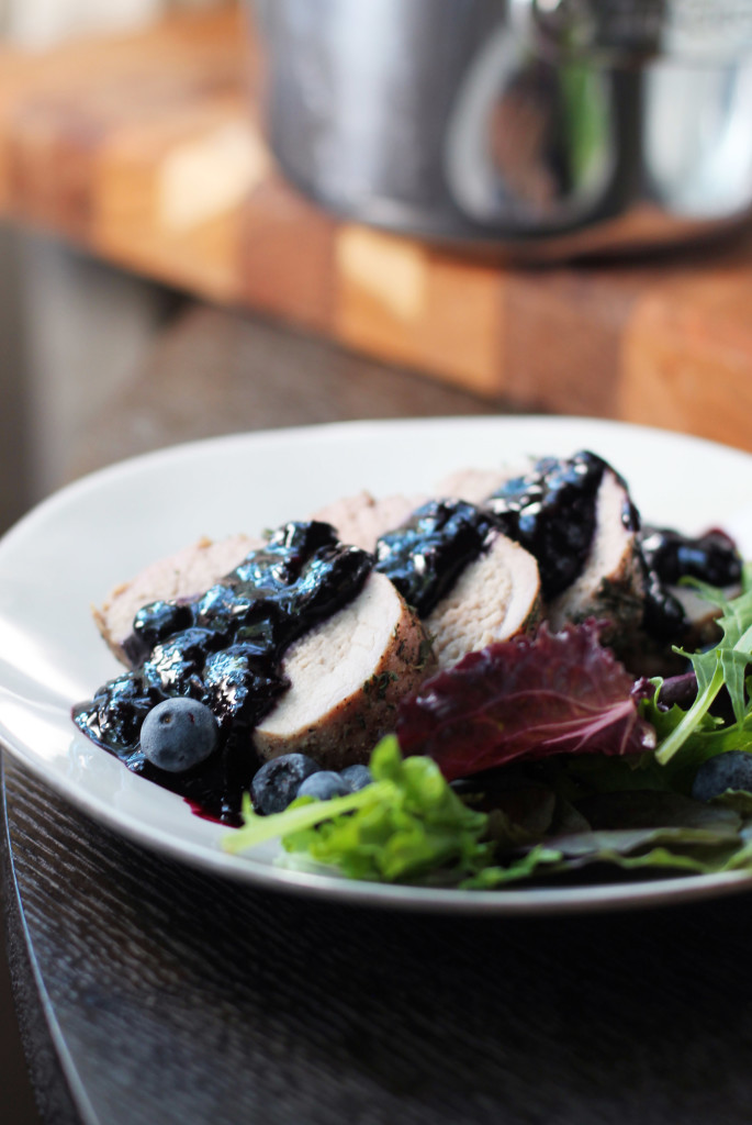 Flavorful and HEALTHY recipe for herbed pork tenderloin topped with a tangy blueberry-balsamic reduction.