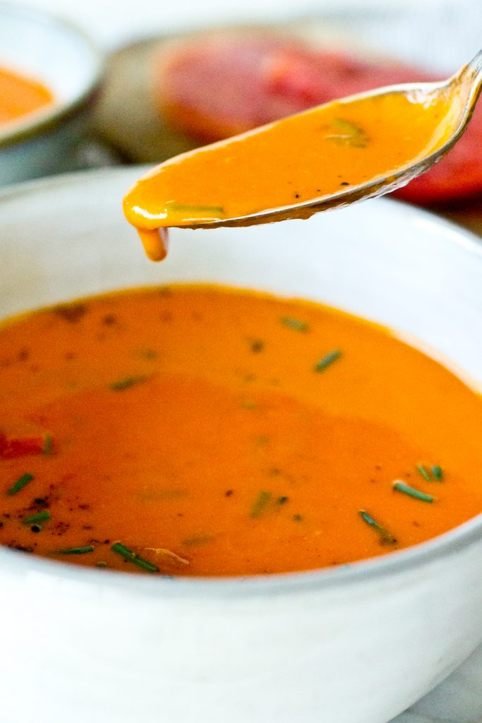 Garden Heirloom Tomato Soup dripping from a spoon