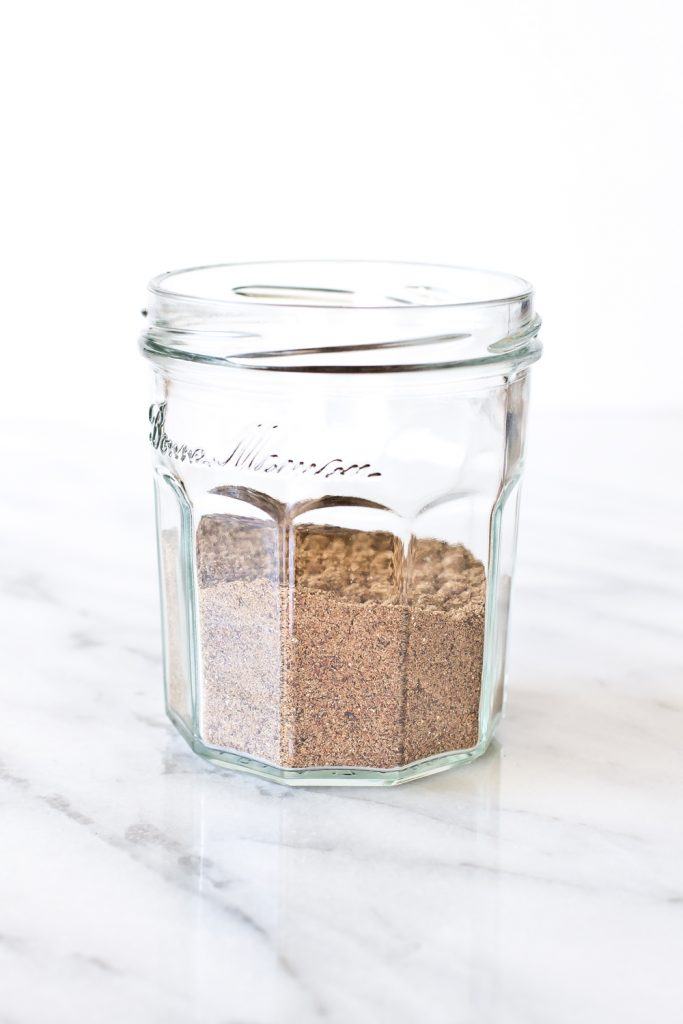 straight on shot of Mekelesha spice blend in a mason jar